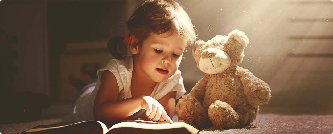 infant reading a book