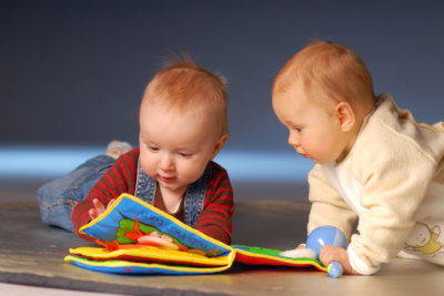Babies playing with toys on floor