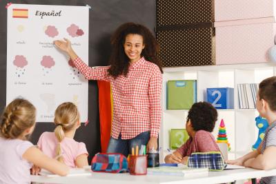 children learning Spanish language with teacher